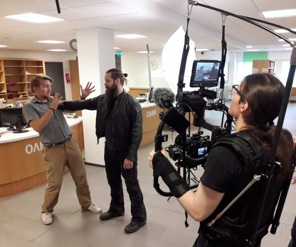 Filming a fight scene in the library.